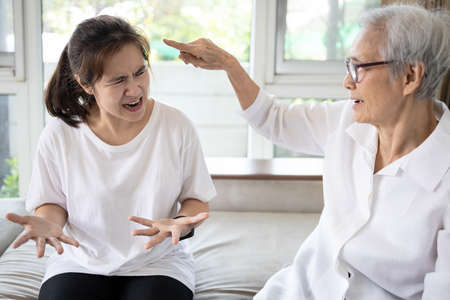 Angry elderly people has quarrel violently with aggressive woman at home,annoyed senior mother pointing finger to daughter,arguing yell at each other,ungrateful,bad relations,family conflict concept