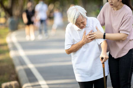 Old elderly with short of breath and chest pain from heart disease, heart attack,holding her hand in the chest,asian senior woman with illness,symptoms of dyspnea,angina,health care,medical emergency