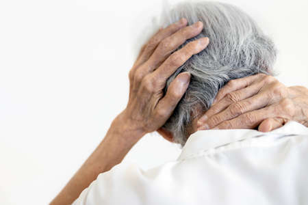 Asian senior woman suffering from scruff pain,occipital bone,stiffness neck,elderly female with painful in the nape of the neck and headache,infectious disease or symptoms of meningitis,brain tumor