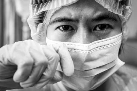 Sad desperate asian woman crying and tears eyes,stressed female doctor or nurse in medical uniform,grieving,eyes full of tears drop,sorrow for the victims of Coronavirus,crisis of COVID-19 pandemic Stock Photo