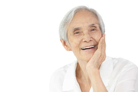 Senior woman touch cheek with hand on her face,feels soft smooth,taking care of delicate sensitive skin,good health of facial skin,old elderly enjoy perfect healthy facial skin,anti age,beauty concept