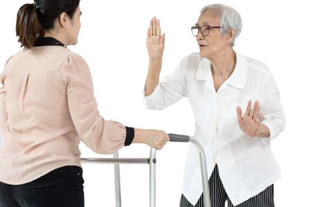 Healthy asian senior woman refusing the use of a walker from physiotherapist after taking health food supplements,healthy again,elderly recovering quickly from injury or illness during rehabilitation