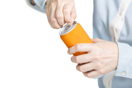 Hands of female using her fingers to open the pull tab of beverage can,unable to open a tin lid to drink,problem pulling the aluminium tab cover of a soft drink can,fingers without strength and weak Stock Photo