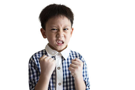 Angry little child clenched fist,show dissatisfied expression on face,feeling upset annoyed,bad behavior,Temperamental kid boy with Attention Deficit Hyperactivity Disorder,irritability,full of anger