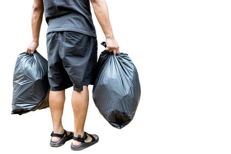Back view,Man holding a black trash bag containing garbage in his hands,two plastic bags of rubbish for separating recycling and general waste,sorting waste for disposal,isolated on white background Stock Photo