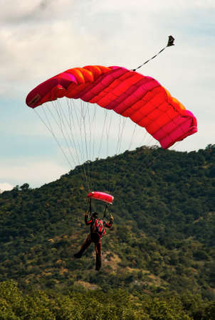 landing: Parachutist landing Stock Photo