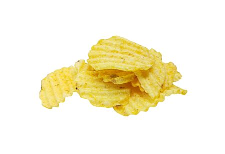 Crispy potato chips isolated on white background. Tasty fried potato slices in closeup Reklamní fotografie