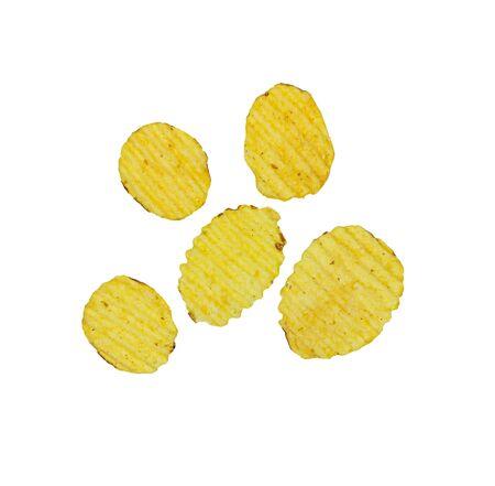 Crispy potato chips isolated on white background. Tasty fried potato slices in closeup