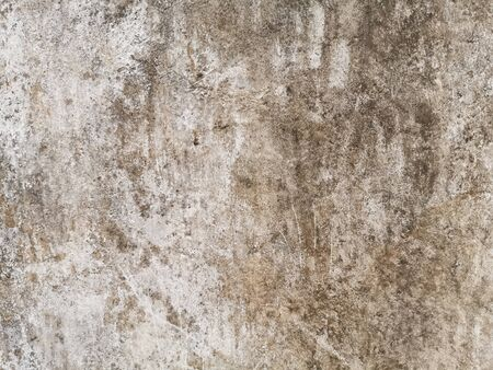 Texture of old gray concrete wall for background and wallpaper. Wall fragment with scratches and cracks