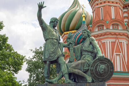 minin: Russia, Moscow, 02.06.2016: St. Basils cathedral and monument to Minin and Pozharsky