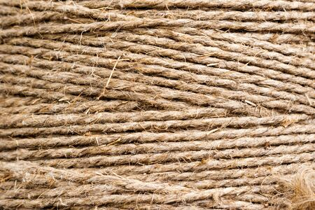 Grunge style concept, background. Hemp rope, skein. Products from hemp.