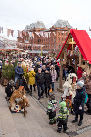 Russia, Moscow: – March 01, 2020: Moscow Maslenitsa Festival. Traditional national celebration in russian folk style. Holiday decor, market, fair at Manezhnaya Square.