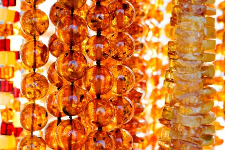 Amber necklace. Amber of different colors and sizes.Stones of amber and a necklace. Background