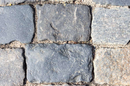 Paving. Paving stones Closeup. Large, rough and old cobblestones that paved Red square in Moscow. 免版税图像