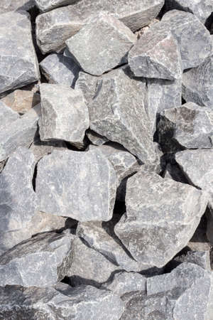 Black and gray rough large stone granite background. Stone texture.