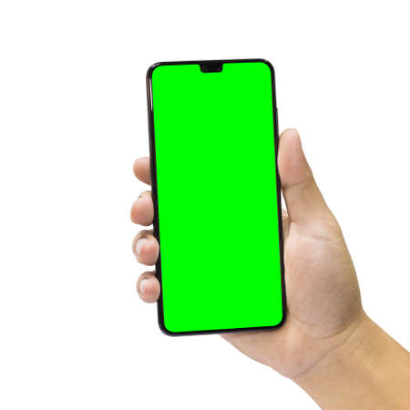 Man holding a black mobile phone with green screen isolated on a white background.