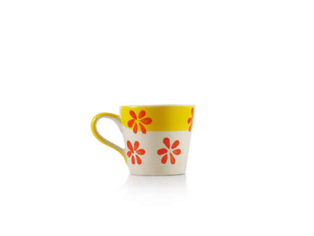 A yellow ceramic cup on white background Standard-Bild