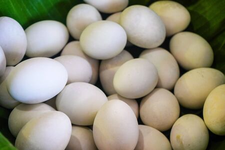 background of fresh eggs for sale at a market. Group of organic free range chicken eggs