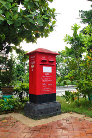 mail slot: Traditional red mail-box in Thailand
