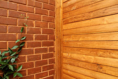 Wood panel background and Red brick wall Stock Photo - 15194674