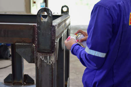Workers use cleaner for remove the penetrant from the welding of structure.This is second step of Penetrant Testing (PT).