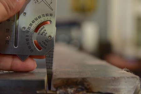 Technician's hand catch the welding gauge to measuring the gap between work part before the welding