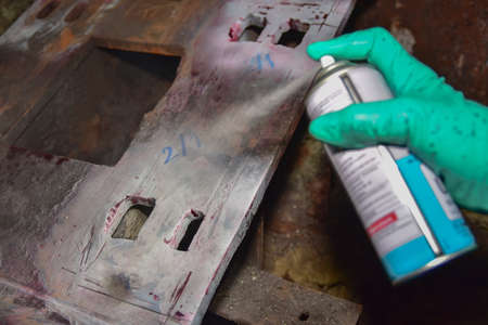 Penetrant Test , worker apply developer to the welding of structure for finding the defect. Stock fotó