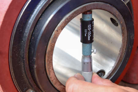 Technician use a Inside Micrometer to measure the diameter inside of the inner ring of bearing.