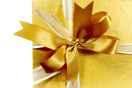 gift box gold colour  isolated photo