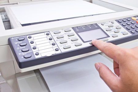 faxing: hand doing photocopy
