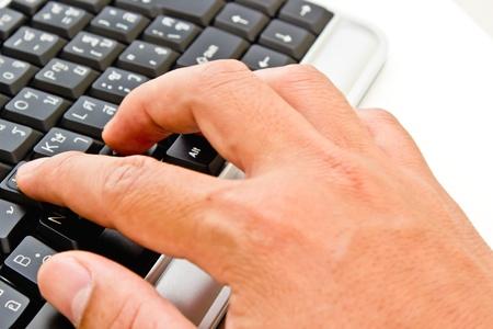 hand pressing keyboard Stock Photo - 12183372