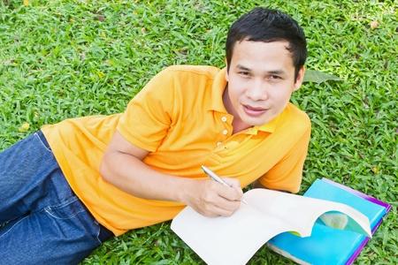 man reading book in garden Stock Photo - 12798775