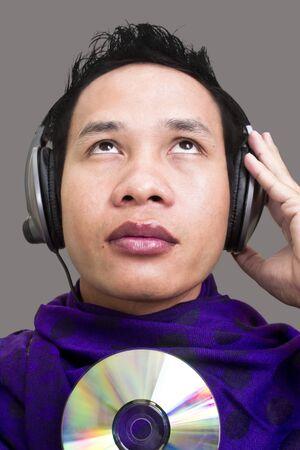 close up asian man face and headphone Stock Photo - 12798885