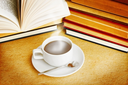 literacy: Hot Coffee Cup And Books With Dramatic Style