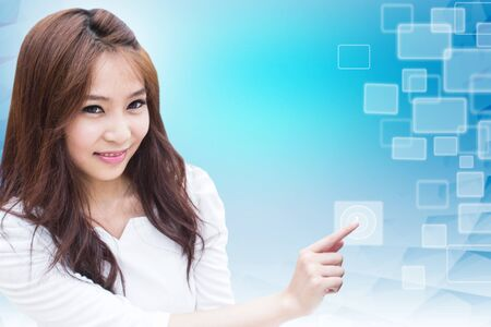 Smart Asian Girl With Touch Screen photo