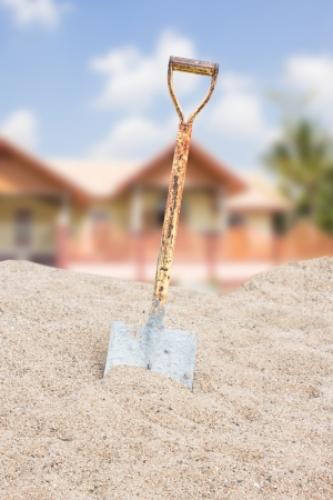 Shovel On Sand For House Construction in Thailand photo