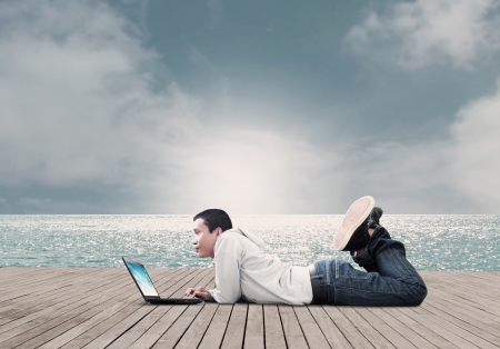 Man Using Laptop On The Beach photo