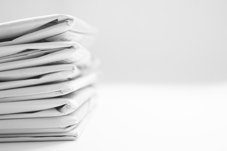 Stack Of Black And White Newspaper Background photo