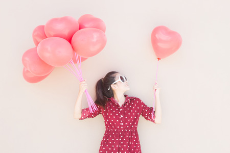 Girl With Colorful Heart Balloons Series ,For Lifestyle ,Celebrate,Fashion Vintage,Valentines Day Concept Stock Photo