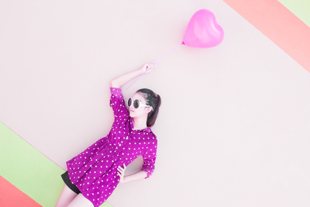 Girl With Colorful Heart Balloons Sitting On Green Grass ,For Lifestyle ,Celebrate,Fashion Vintage,Valentines Day Concept photo