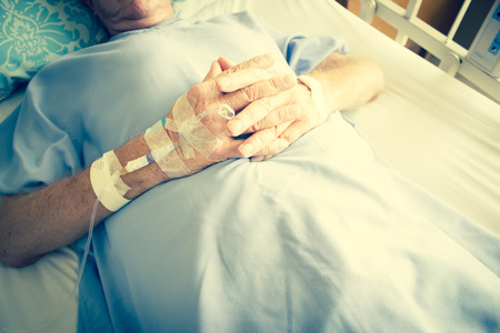 surgical department: Close Up Shot Of Patient In Hospital Bed And Having Iv Solution Drop In Patient Hand,Healthcare And Medical Concept Background,Filter Image