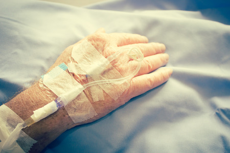 surgical oncology: Close Up Shot Of Iv Solution Drop In Patient Hand,Healthcare And Medical Concept Background,Filter Image Stock Photo