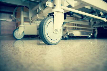 wheel chair: Close Up Hospital Bed Wheels Concept And Ideas For Healthcare And Medical Background Stock Photo