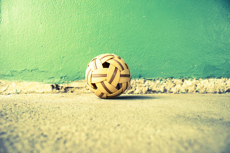 traditional sport: Sepak Takraw Ball On Cement Floor Background,Asia Traditional Sport Games Stock Photo