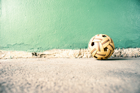 traditional sport: Sepak Takraw Ball On Cement Background,Asia Traditional Sport Games