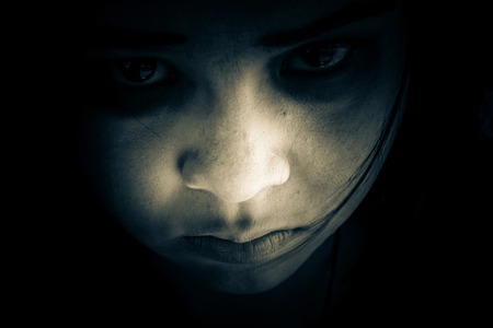 Out from the dark,Portrait of scary girl staring at cameras,Ghost girl hiding in the dark,Horror background for halloween