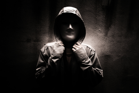 mysterious woman: Dark doctrine,Mysterious woman wearing white mask under hoodie,Scary background for book cover