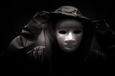 white mask: Dark doctrine,Mysterious woman wearing white mask under hoodie,Scary background for book cover