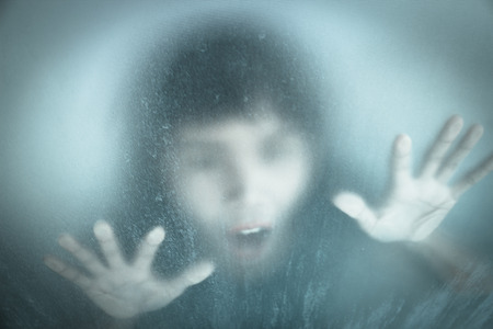 No panic,woman screaming behind stained or dirty window glass,Scary background for book cover