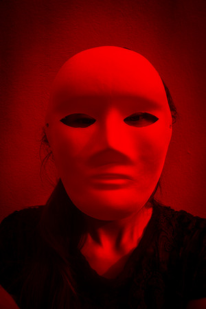 mysterious woman: Face of mysterious woman wearing white mask,Scary background for book cover Stock Photo